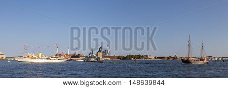 Copenhagen, Denmark - September 14, 2016: Panoramic harbor view with the royal yacht Dannebrog and a sailboat