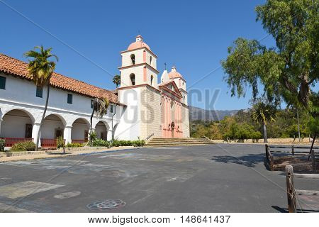 SANTA BARBARA, CALIFORNIA - SEPTEMBER 21, 2016: Mission Santa Barbara Plaza. Remnants of street paintings adorn the area in front of the mission.