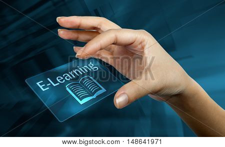 a woman hand with a digital card with the word e-learning