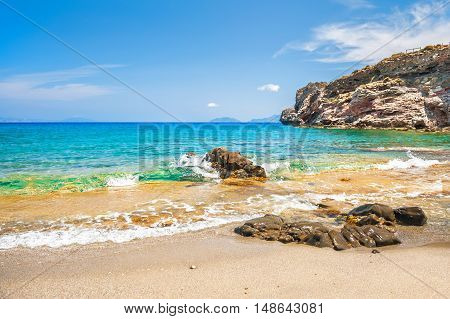 Beautifu Tropical Beach With Clear Turquoise Water And Rocks.