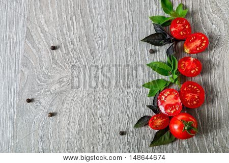 Cherry Tomatoes And Fresh Basil On Grey Wooden  Background. Frame. Copy Space.