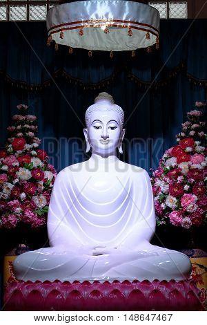 White Jade Buddha on lotus statue in main buddhist building of Temple, Wat Bumpeannua ,Bangkok,Thailand.