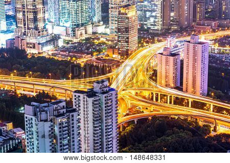 modern buildings and road junction in shanghai at night