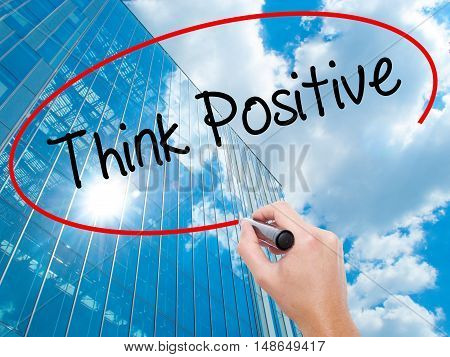 Man Hand Writing Think Positive With Black Marker On Visual Screen