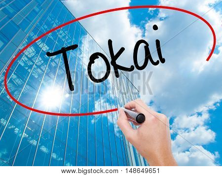 Man Hand Writing Tokai With Black Marker On Visual Screen