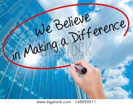 Man Hand Writing We Believe In Making A Difference With Black Marker On Visual Screen