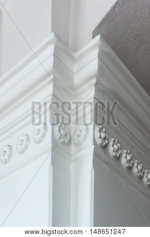 a column-decorative architectural element made of plaster