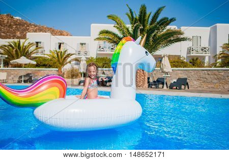 little girl enjoy vacation in the swimming pool