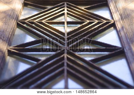 The metal grille in the style of Art Deco on doors of an old house early twentieth century Window with decorative ornamented iron lattice.