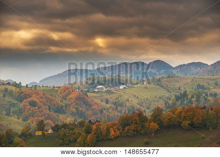 Autumn panorama in the mountains, at sunset