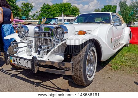 Kharkiv Ukraine - May 22 2016: Neo-classic motor car white Zimmer Golden Spirit manufactured in 1982 is presented at the festival of vintage cars Kharkiv Retro Rally - 2016 in Kharkiv Ukraine on May 22 2016