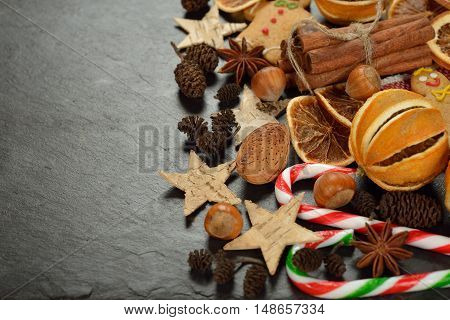Various Christmas ingredients on a stone background