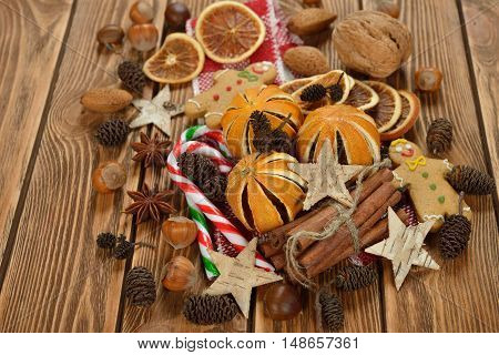 Various Christmas ingredients on a brown background