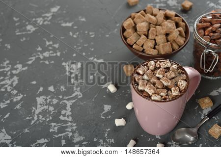 Delicious hot chocolate with marshmallow on the vintage background