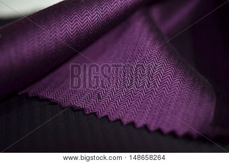 close up purple fabric of shirt photo shoot by depth of field for object