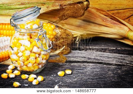 corncob and corn on the cob in preserving jar