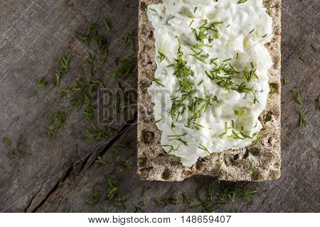Crisp bread sandwich with cream cheese and fresh herbs