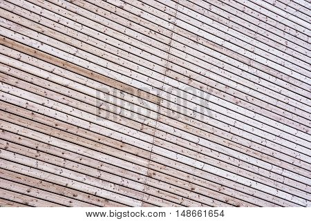 Background of geometric wooden texture. Building material. Abstract graphic resource.