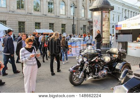 St. Petersburg, Russia - 12 August, Different holiday visitors,12 August, 2016. The annual International Festival of Motor Harley Davidson in St. Petersburg Ostrovsky Square.
