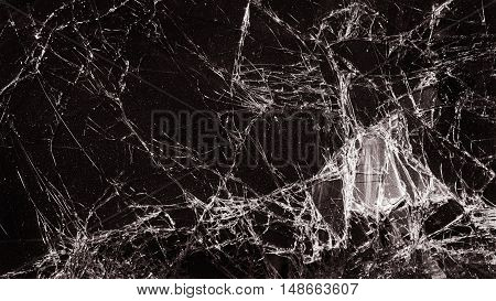 Broken Cracked Glass With Big Hole Over Dark Background