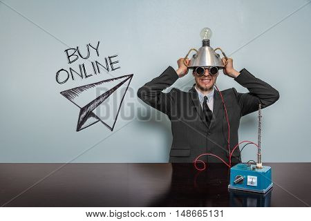 Buy Online text with vintage businessman and machine at office