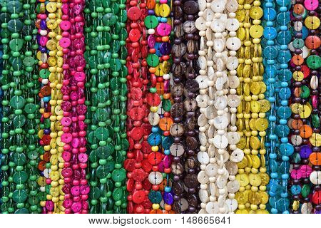 garlands of colored artificial and natural stones as an abstract or travel background