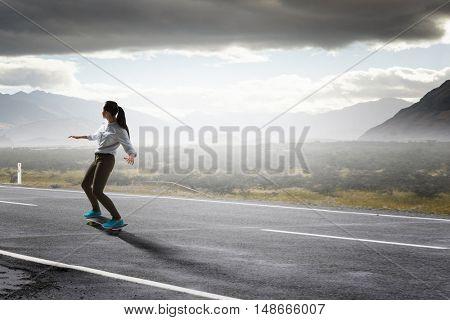 Girl ride skateboard . Mixed media