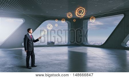 Businessman use modern technologies . Mixed media