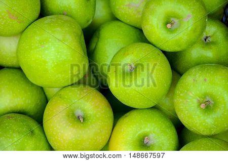 fresh juicy Green Apple Background. texture. Georgia
