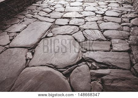Tinted Urban Road Is Paved With Blocks Of Stone, Cobblestone Walkway