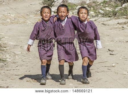 Paro Bhutan 18th October 2012: Three schoolboys on the way home