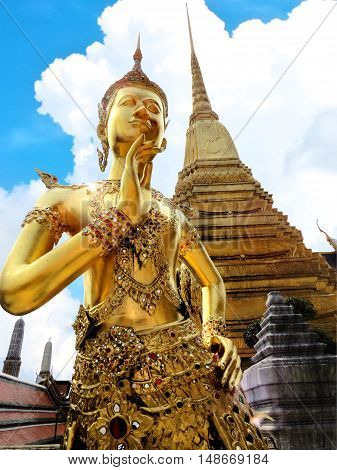 Golden Thep Kinnanorn statue at Temple of Emerald Buddha (Wat Phra Kaew) in Grand Royal Palace (The upper body as human and lower as bird) ,Bangkok,Thailand. Selective focus.