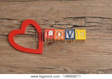 Valentine's Day. Love Spelled with colorful alphabet blocks and a red heart.