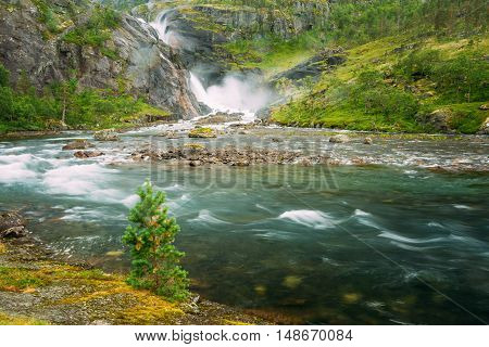 Beautiful Waterfall In The Valley Of Waterfalls In Norway. Husedalen Waterfalls Were A Series Of Four Giant Waterfalls In The South Fjord.