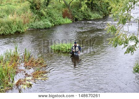 Upper view of fly fisherman fishing in river