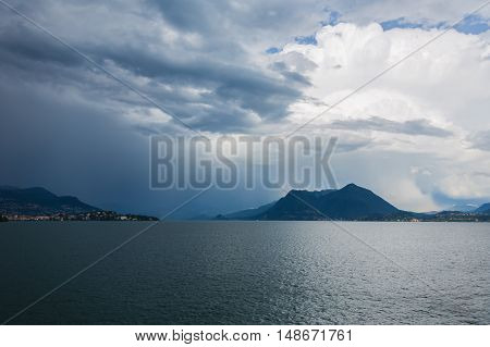 view over Lago Maggiore and surrounding Alps Northern Italy