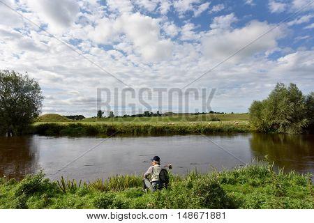 Fisherman waiting on riverbanks