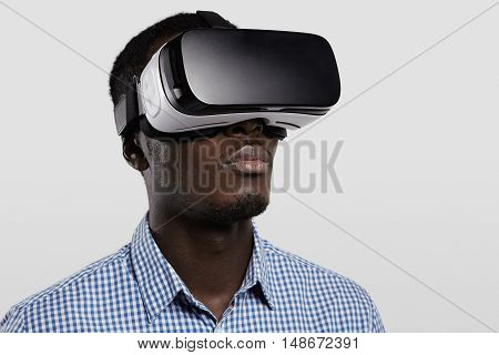 Technology, Entertainment, Gaming, Cyberspace And People Concept. Serious Dark-skinned Player Wearin