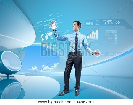 Young businessman navigating holographic virtual reality interface