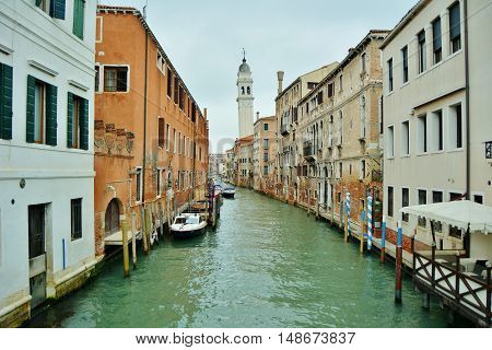 A Venetian canal, a leaning tower and many stories