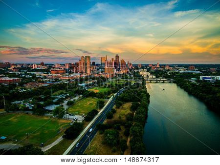 Austin Texas Dramatic Colorful Sunset Aerial Over Town Lake looking at the Golden Hour Reflections with all colors of the Rainbow over the central texas capital city