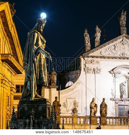 Night View Of Statue Of Czech King Charles IV In Prague, Czech Republic. Real Full Moon Above Crown