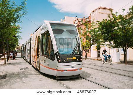Seville, Spain - June 24, 2015: Modern tram Tussam on the line