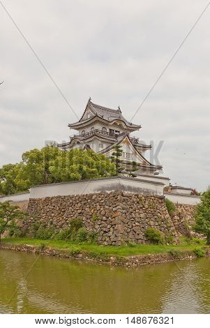KISHIWADA JAPAN - JULY 24 2016: Main keep of Kishiwada castle Japan. Erected in 1585 burned down in 1827 reconstructed in 1954