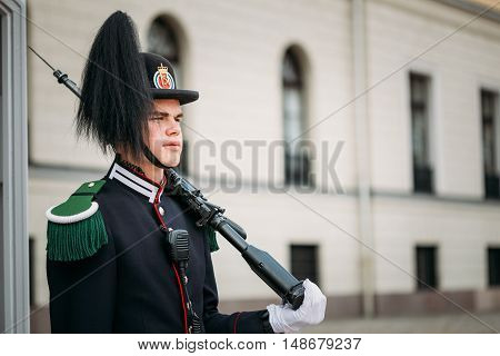 Oslo, Norway - July 31, 2014: The Young Man In Special Uniform Of  Royal Guard, Household Troops Standing In Sentry With Weapon Gun Next To The Royal Palace.