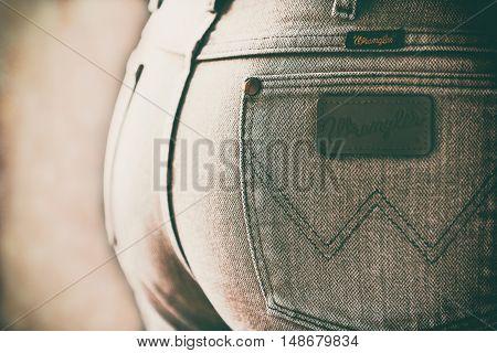 Estonia, Tallinn, 12.12.2015. Wrangler jeans emblem. Retro photo style, with film grain toned image. Selective focus