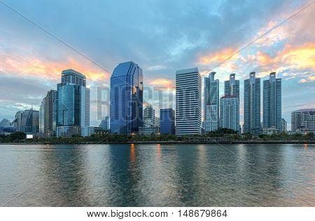 Aerial view of Bangkok modern office buildings, condominium in Bangkok city downtown with sunset sky , Bangkok , Thailand