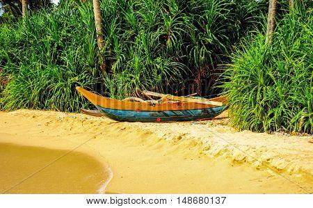 old fishing boat on beach. sril lanka