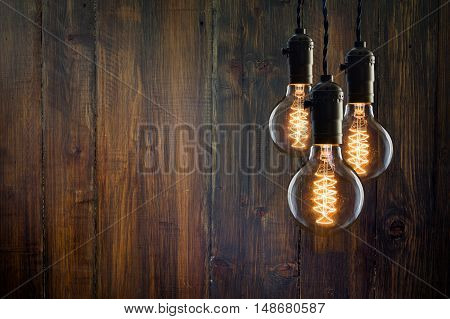 Vintage Incandescent Edison Type Bulbs On Wooden Background