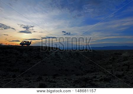 Camper van at sunset in nice valley of the tatacoa desert, colombia.